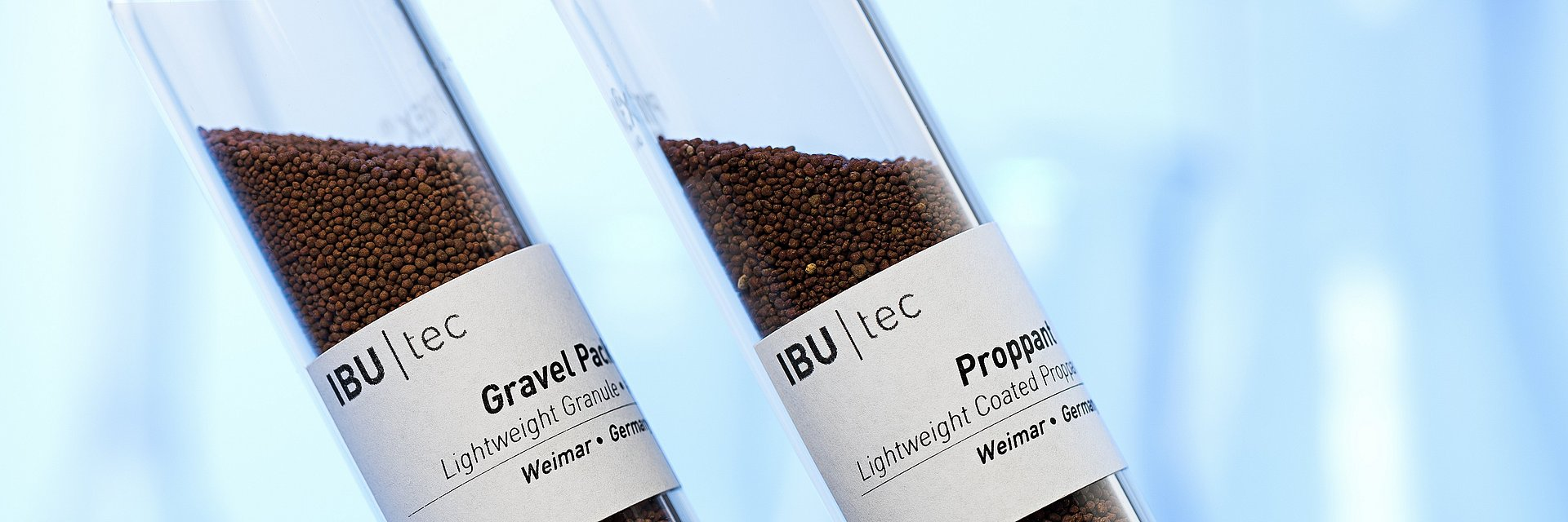 proppants and gravel pack in test tubes for mining or extraction of oil or gas from IBU-tec development